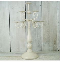 Metal cream candelabra with 10 placements for candles