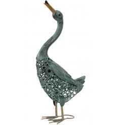 A charming duck figure with a stamped floral body and painted green finish.