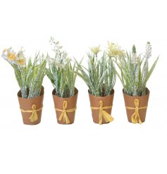 A mix of frosted flower pots with brown kraft paper planters, complete with raffia bows.