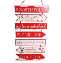 A large multi-tier Christmas sign in traditional red and white colours.