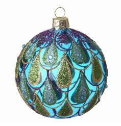 A stunning blue glass bauble decorated in glitter peacock feathers.