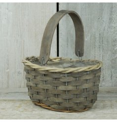 A basket style trug with a greywash finish and inner lining