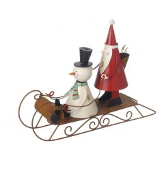 A fabulous Santa and Snowman on sledge with a shabby chic metal finish.
