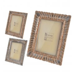 2 assorted stylish photo frames with an antique copper finish.