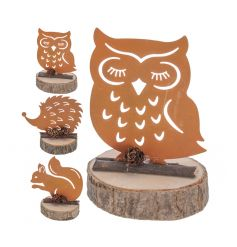 A mix of copper animal figures set on a rustic bark base with mini acorns.