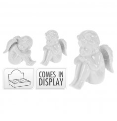 A mix of classic white cherub decorations making a chic festive decoration.