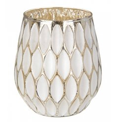 A stunning leaf design t-light holder in white and antique gold.