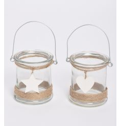 A glass lantern with rope detailing and hanging star/heart detailing.