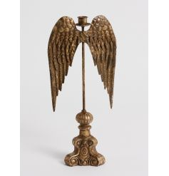 A stunning tall candlestick holder in an antique gold finish.
