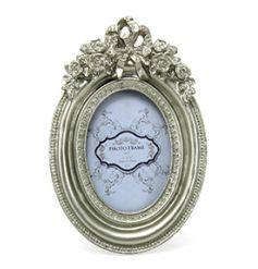 Picture frame with an ornate finish in a champagne colour