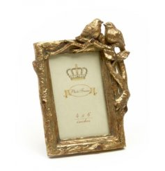 Add a vintage chic vibe to your home with this classy gold painted photo frame