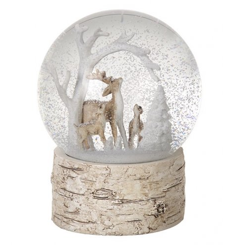 A chic woodland inspired snow globe housing a reindeer family and snow covered trees.