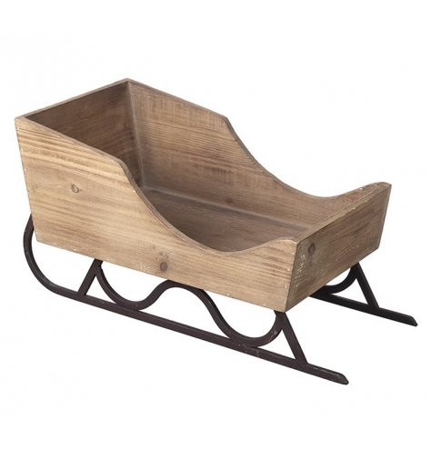 A table top sized wooden sleigh with metal base. Ideal for displaying ornaments, decorations and gifts.