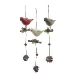 Festive hanging bird decorations in traditional Christmas colours.