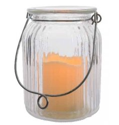 Glass jar style lantern with wire handle, comes with a removable LED flickering candle.
