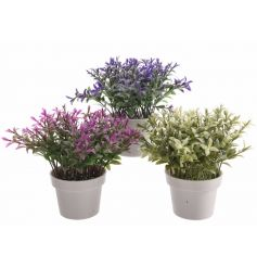 An assortment of 3 colourful artificial flowers set within pots.