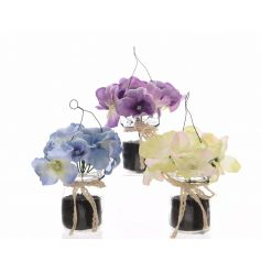 A mix of 3 silk artificial hydrangea flowers set within glass pots. Each pot is finished with vintage lace ribbon.