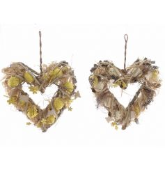 A mix of 2 pretty Spring heart shaped wreaths complete with decorative flowers, feathers and butterflies.