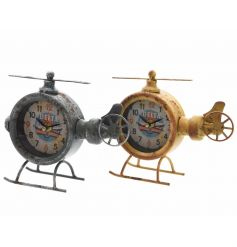 A mix of two antique style helicopter clocks in green and yellow colours.