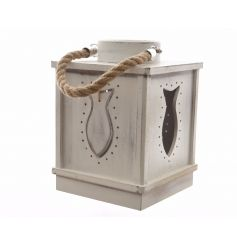 A charming coastal inspired lantern with a chunky rope handle and fish design.