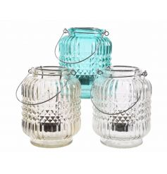 A mix of 3 stylish glass lanterns in clear, amber and blue colours.