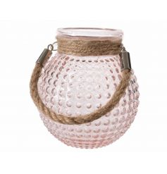 A stylish bubble glass lantern in pink with a chunky rope handle.