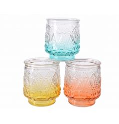 An assortment of 3 decorative glass t-light holders in orange, yellow and blue colour flow designs.