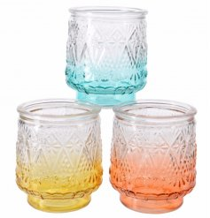 An assortment of 3 colour flow glass t-light holders in peach, yellow and aqua colours.