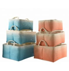 A mix of 2 storage baskets in aqua and peach two-tone designs.
