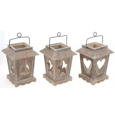 Beautifully shaped Christmas lanterns with star, tree and heart designs. Finished with a metal handle to hang if desired