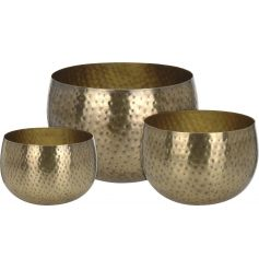 A set of 3 gorgeous round planters in gold with a hammered finish.