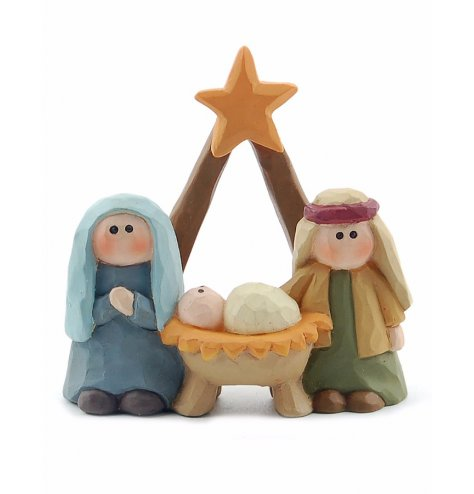 A miniature nativity scene featuring a star topped manger. This decoration has a carved wood effect finish.