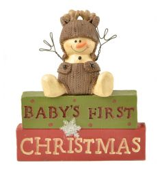 A charming Baby's First Christmas block sign with an adorable snowman figure dressed as a reindeer.