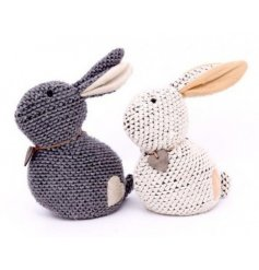 An assortment of 2 cosy and charming knitted rabbit doorstops with a heart patch and collar.