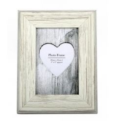 A stylish shabby chic photo frame in cream.