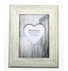 A shabby chic style photo frame in cream. A great gift item and interior decor item.