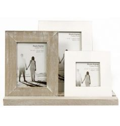 3 assorted sized and colour picture frames rested on a wooden tray