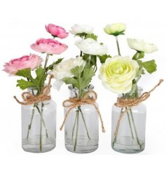 An assortment of 3 pretty floral arrangements set within a glass jar.