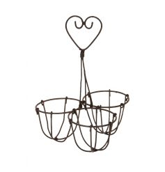 A rustic style egg holder with a decorative heart handle.