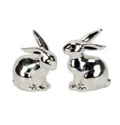 An assortment of 2 silver bunny ornaments with a shiny finish. A stylish seasonal decoration for the home.