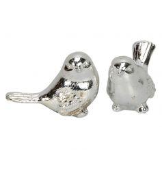 An assortment of 2 decorative silver bird ornaments.