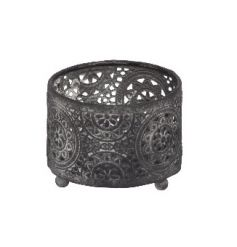 A decorative metal t-light holder with a rustic finish and a decorative pattern.