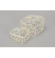 A set of 2 cream wire trinket boxes in the shape of hearts.