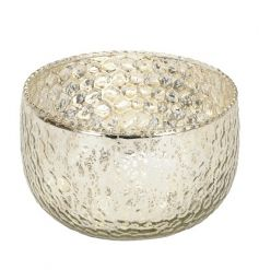 A glamorous champagne coloured glass t-light holder with a decorative surface pattern.