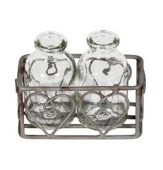 A set of 2 miniature milk bottles set within a rustic grey tray with hearts. A charming decorative accessory.