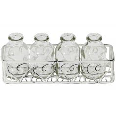A shabby chic style metal tray with decorative hearts and 4 miniature milk bottles.