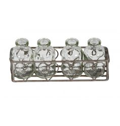 A rustic metal tray with decorative hearts and 4 miniature milk bottles. A pretty decorative holder, ideal for flowers.