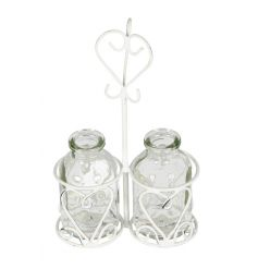 A shabby chic style cream miniature bottle holder with bottles. A chic decoration, ideal for popping hand cut flowers in