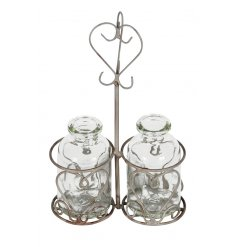 A miniature twin milk bottle holder with bottles. A chic decoration, ideal for popping a sprig of flowers in.