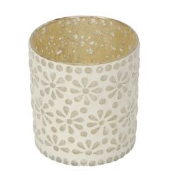 A decorative t-light holder with a cream floral pattern.